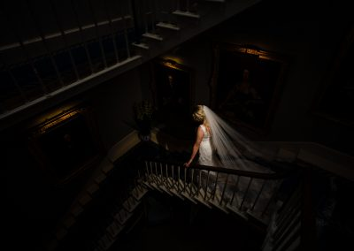 Creative picture of bride decending staircase