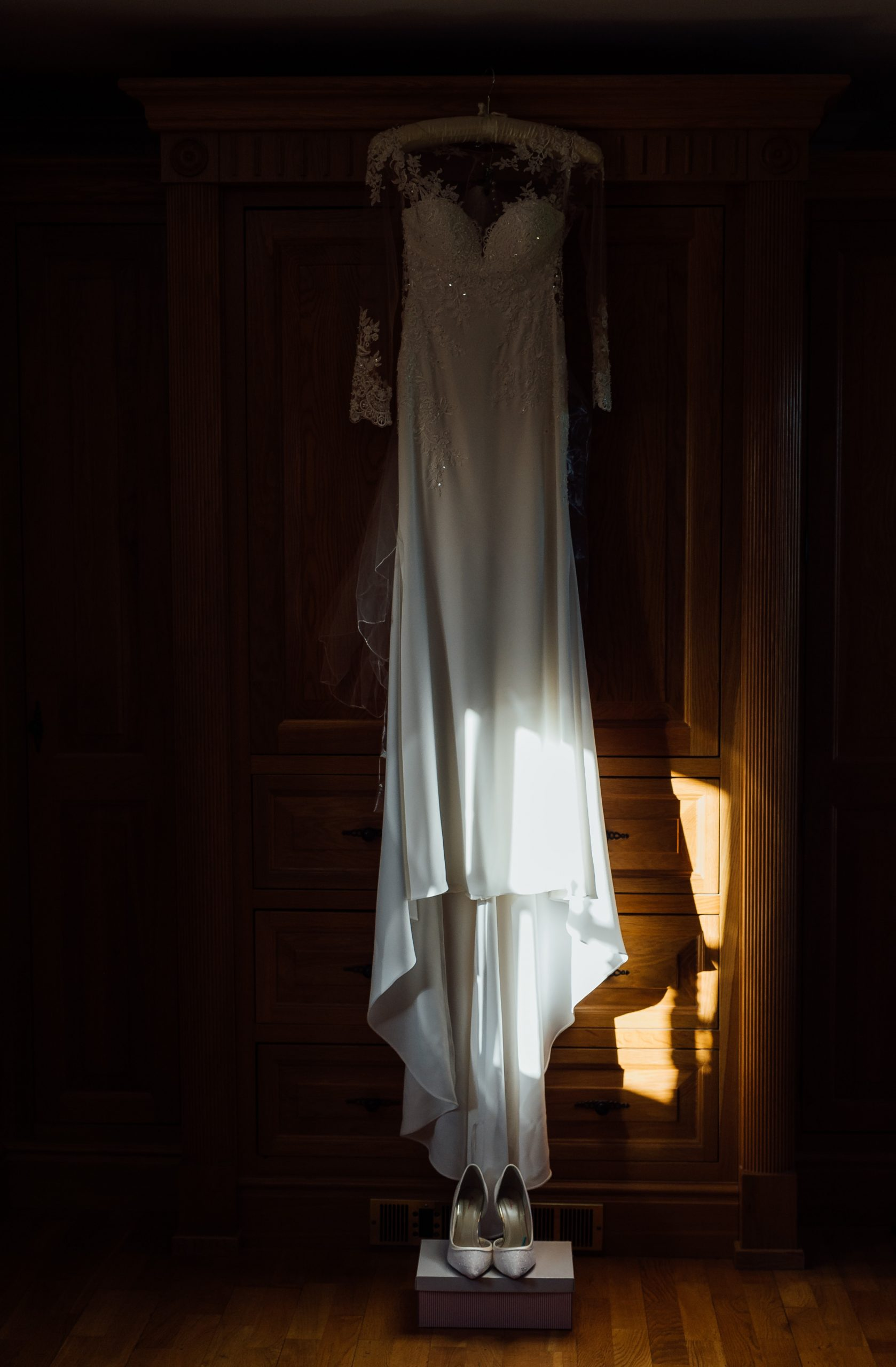 Brides dress hung in bridal suite