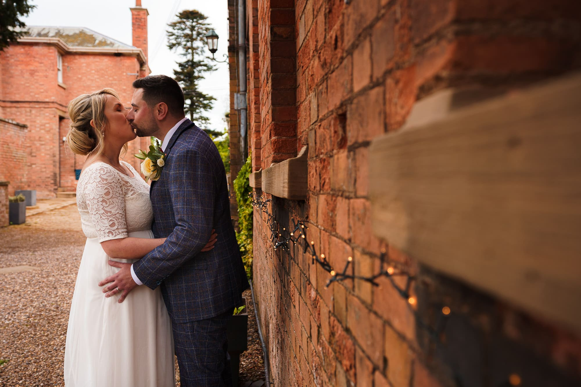 Bride and Groom kissing at Norwood Park Wedding