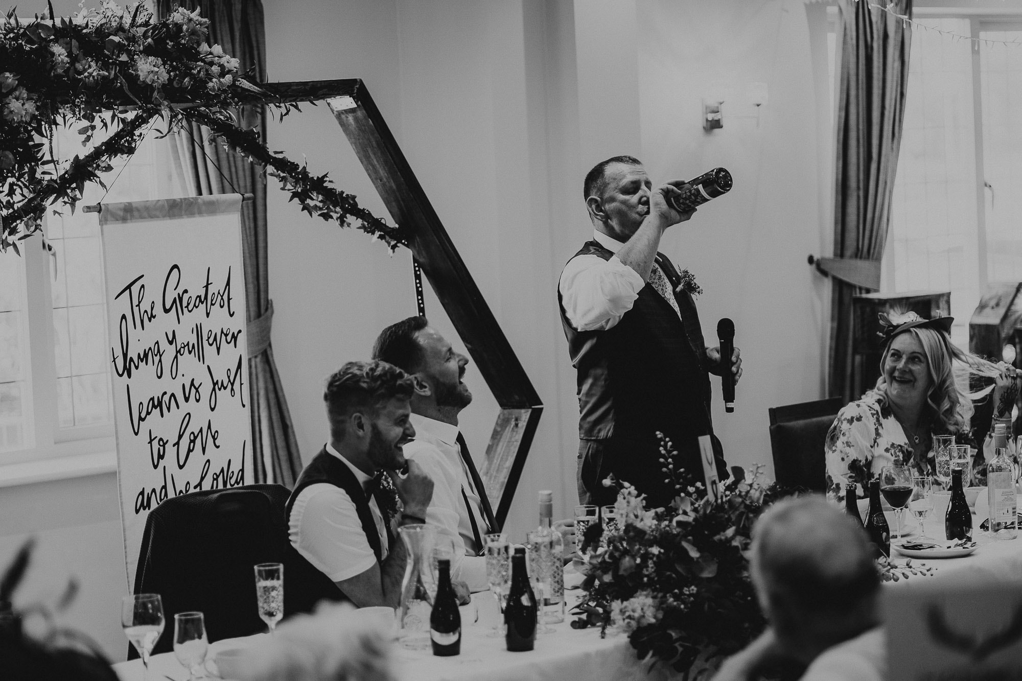 father of the groom drinking during speeches
