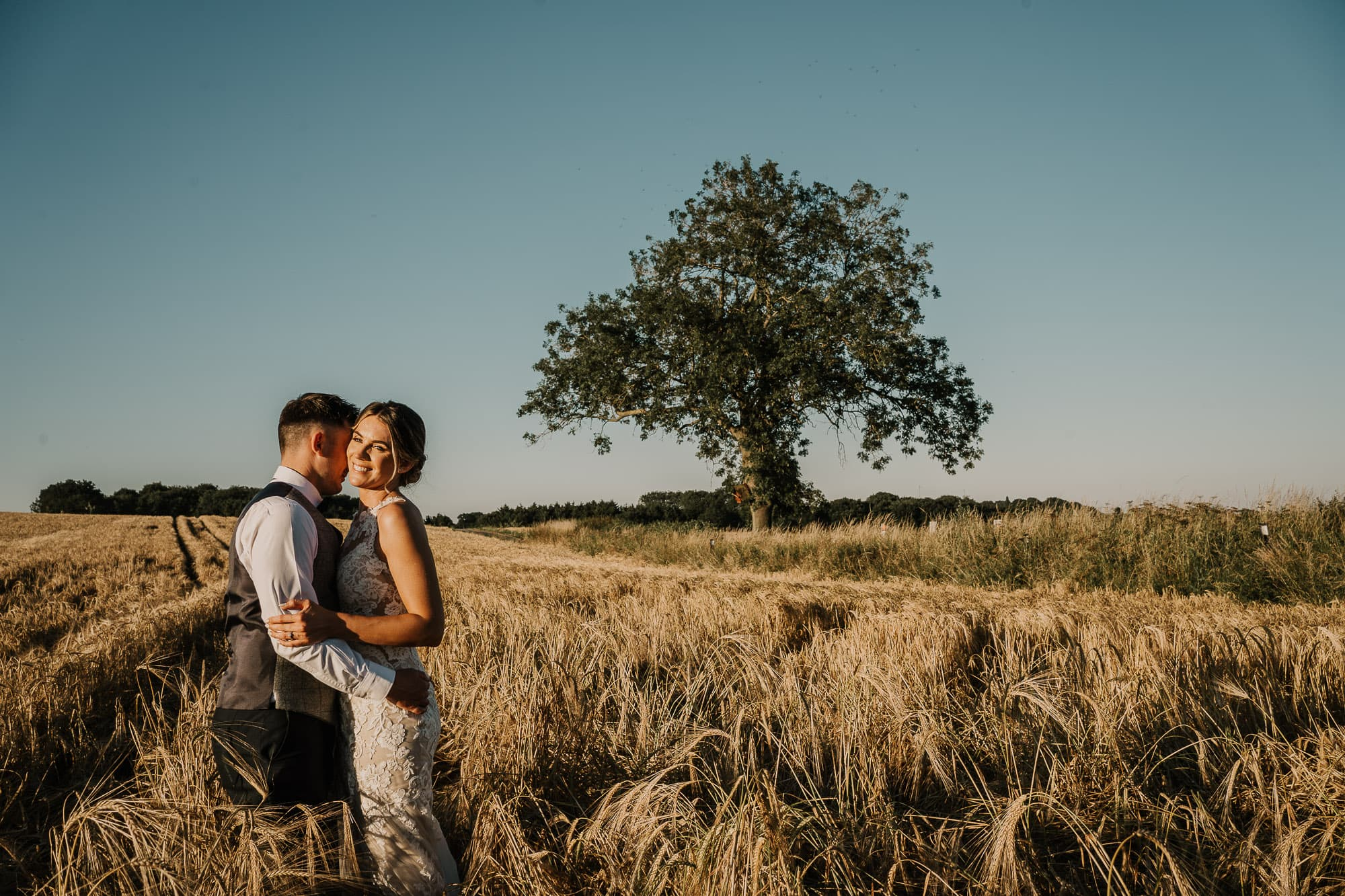 Bride and Groom in Wheat field at Swancar Farm