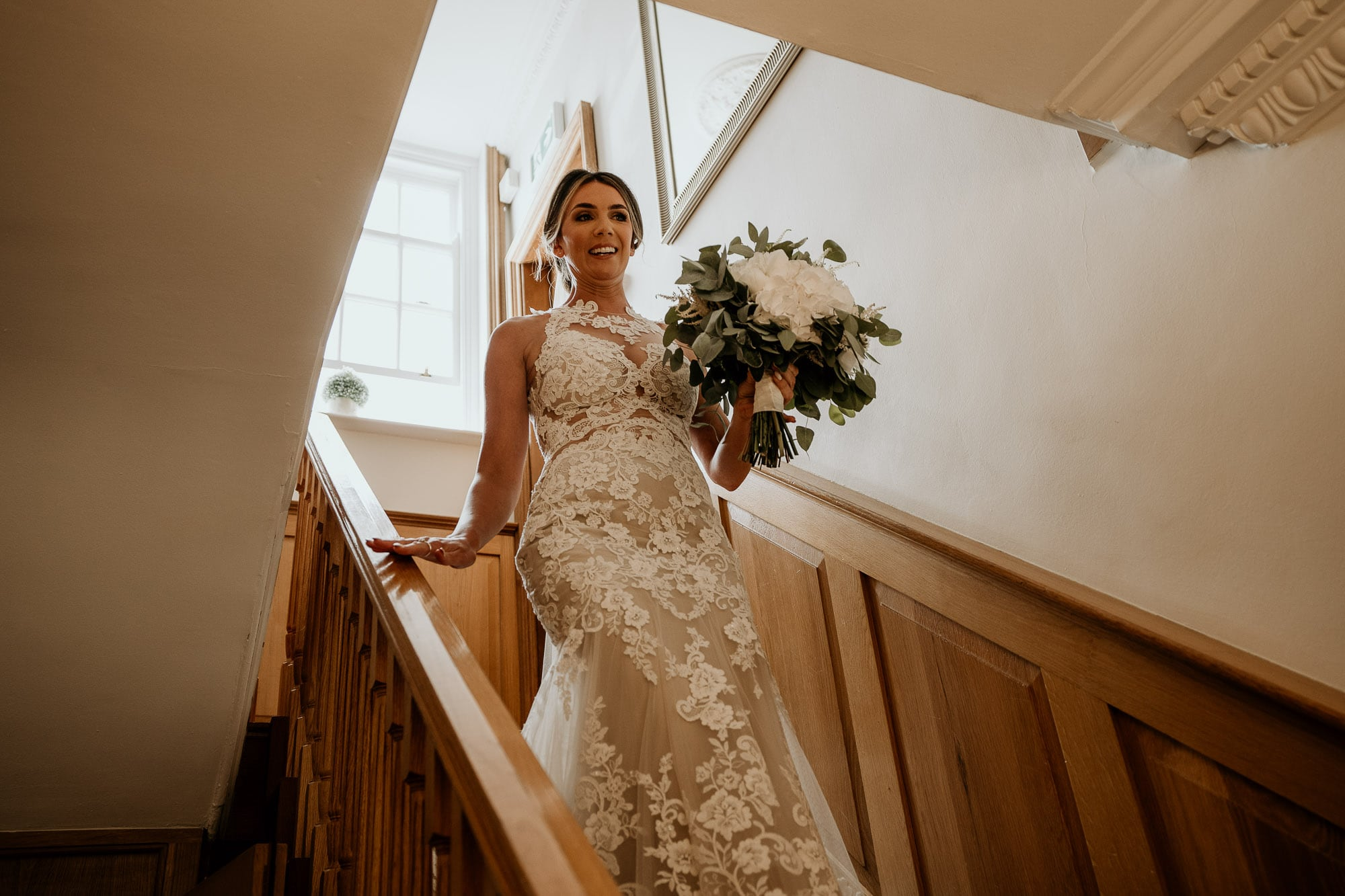Bride walking towards father on morning of wedding day