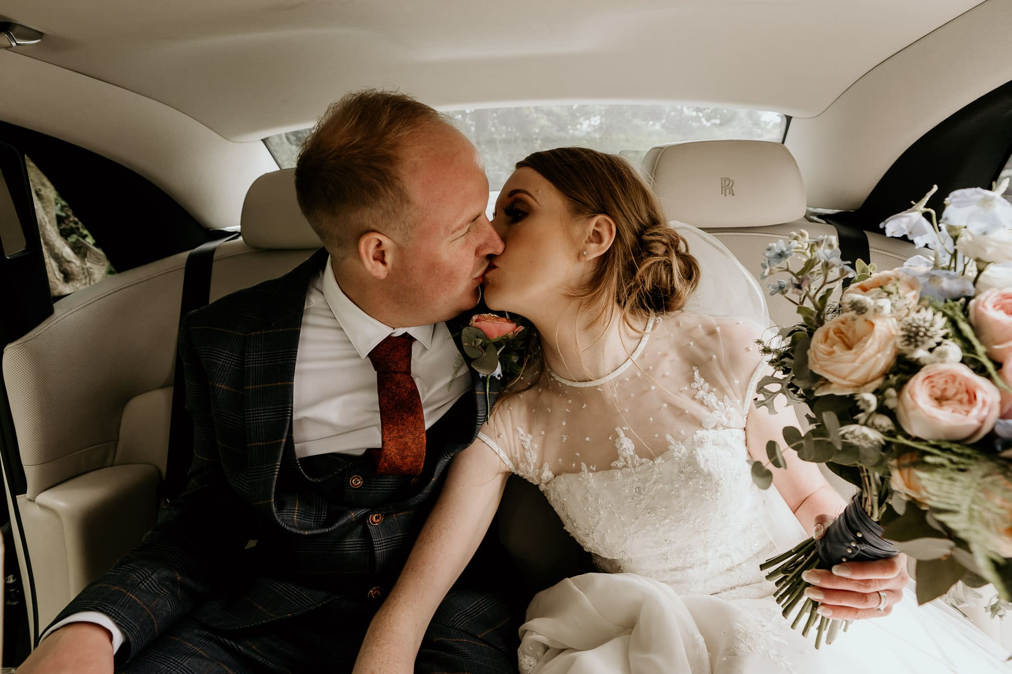 Bride and groom in wedding car at Cubley Hall