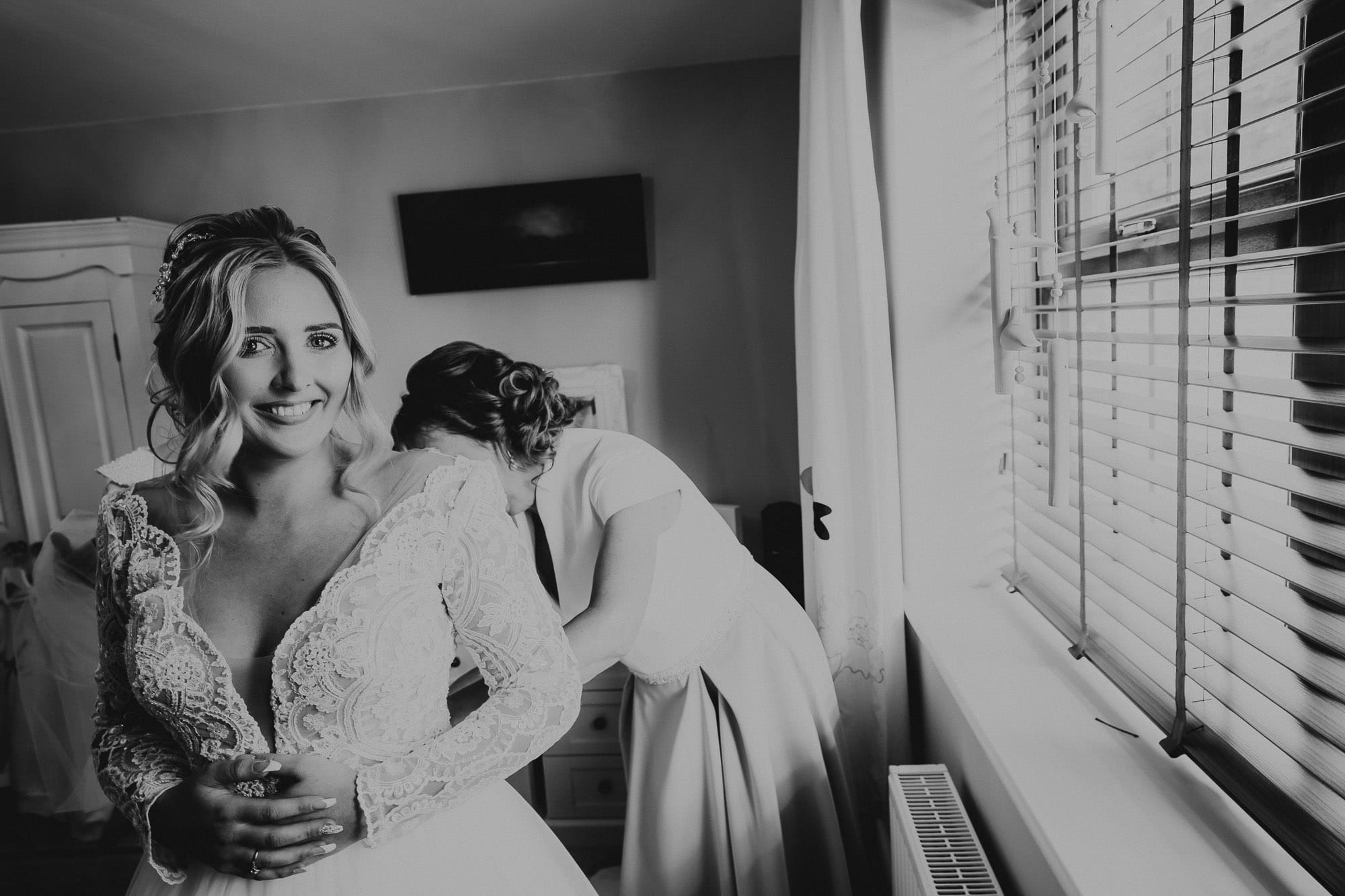 Bride getting in to wedding dress in Chesterfield
